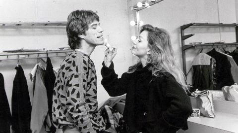 Jagger has makeup applied backstage in 1984.