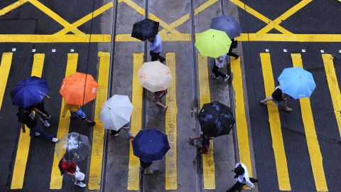 Umbrellas are out in force at an intersection in Hong Kong on Thursday, July 25.