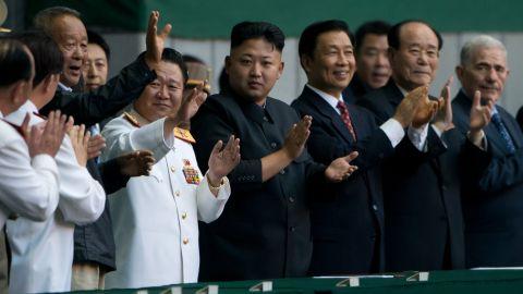 North Korean leader Kim Jong Un, center, applauds before the Arirang Festival at the 150,000-seat Rungrado May Day Stadium in Pyongyang on July 26.
