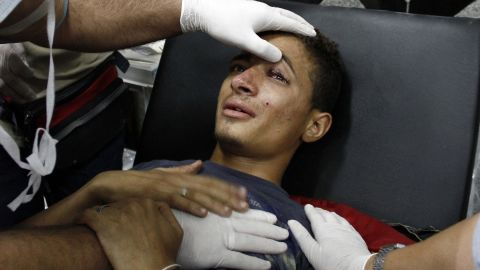 Doctors treat a Morsy supporter injured during clashes with security forces in Cairo on July 27.