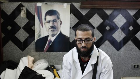 A medic pauses at a field hospital in Cairo on July 27 after tending to the bodies of Morsy supporters reportedly killed in fighting.