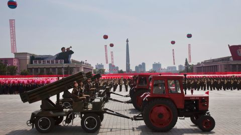 Tractors pull weapon-bearing wagons during the parade on July 27.