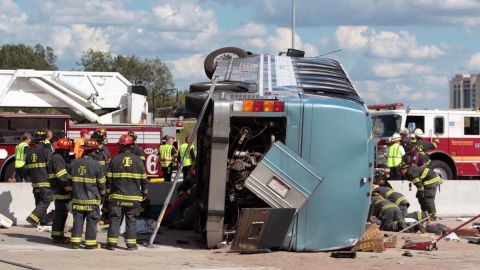 Firefighters work to extricate people from a bus crash Saturday, July 27, in Indianapolis.