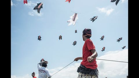 People fly kites during the Bali Kite Festival in Denpasar, Indonesia, on Saturday, July 27.