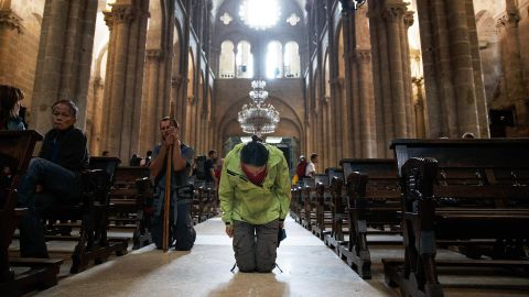 A woman kneels on July 29 in the cathedral.