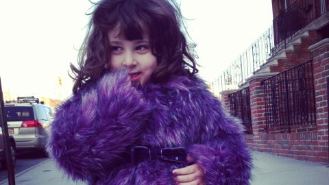 """The latest craze of parents' photos floating around the Internet: children with style and swag. By now you might have seen a Tumblr or Pinterest board with pictures of toddlers striking sassy poses. Julia Samersova, a casting director and blogger who runs """"Planet Awesome Kid"""" in Brooklyn, sees kid swagger in her neighborhood every day. Here, her own daughter, Violet, strikes a pose in a purple furry coat."""