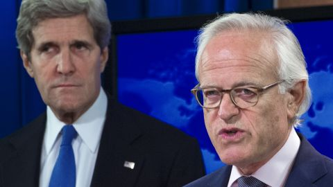 John Kerry is pictured on Monday after announcing former US ambassador to Israel, Martin Indyk (R), will head the peace talks.