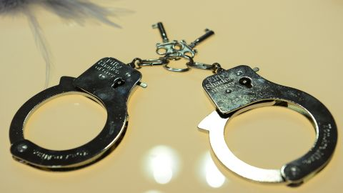 """Handcuffs are on display at the """"Fifty Shade of Grey"""" booth, featuring the """"official pleasure collection"""" inspired and approved by best seller author E.L. James"""
