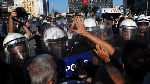 Turkish police attempt to disperse anti-government protestors during a demonstration near the entrance of Taksim Square on July 20, 2013, in Istanbul. Police dispersed on July 20 hundreds of protesters who gathered around Gezi Park, the bastion of anti-government protests that shook Turkey in June, to attend the wedding of two protesters. AFP PHOTO /BULENT KILICBULENT KILIC/AFP/Getty Images