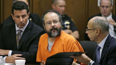 Ariel Castro listens during the sentencing phase of his trial on August 1 in Cleveland alongside defense attorneys Craig Weintraub, left, and Jaye Schlachet. Castro held three women captive for years inside his Ohio home until their escape in May 2013. He pleaded guilty to 937 counts, including murder and kidnapping. On September 4, Castro was found dead inside his prison cell in Orient, Ohio.