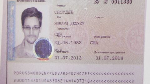 """Snowden's refugee document granted by Russia is seen during a news conference in Moscow on August 1. Snowden slipped quietly out of the airport <a href=""""http://www.cnn.com/2013/08/01/us/nsa-snowden/index.html?hpt=hp_t2"""">after securing temporary asylum in Russia</a>, ending more than a month in limbo."""