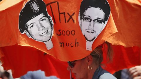 """Demonstrators in Berlin hold a protest march on Saturday, July 27, in support of Snowden and WikiLeaks document provider Bradley Manning. <a href=""""http://www.cnn.com/2013/08/01/us/snowden-manning/index.html"""">Both men have been portrayed as traitors</a> and whistle-blowers. Manning was acquitted on July 30 on the most serious charge of aiding the enemy, but he was convicted on several other counts and likely faces a lengthy term in a military prison."""