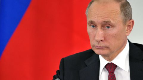 Russian President Vladimir Putin attends a meeting in Prokhorovka on July 12. Russian officials said Snowden abandoned his effort to seek asylum in the country after Putin warned that he would have to stop leaking information about U.S. surveillance programs if he wanted to stay.
