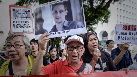 Protesters in Hong Kong shout slogans in support of Snowden on June 13. The NSA leaker vowed to fight any bid to extradite him from Hong Kong.