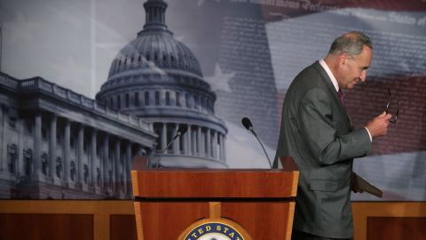 """Sen. Charles Schumer, D-New York, leaves a last-minute news conference at the U.S. Capitol after Russia announced that it would grant Snowden temporary asylum on August 1. """"Russia has stabbed us in the back, and each day that Mr. Snowden is allowed to roam free is another twist of the knife,"""" he said."""