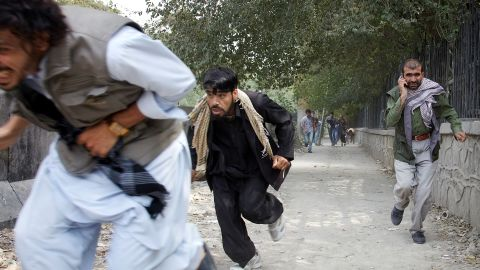 """People flee the scene of a Taliban attack on the <a href=""""http://news.blogs.cnn.com/2011/09/13/u-s-embassy-in-afghanistan-attacked-taliban-claims-responsibility/"""">U.S. Embassy in Kabul, Afghanistan,</a> on September 13, 2011. Three police officers and one civilian were killed. There were no reports of U.S. casualties."""