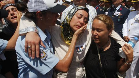 """Relatives of slain police officers are comforted during a funeral in Istanbul, Turkey, on July 10, 2008, a day after the <a href=""""http://news.bbc.co.uk/2/hi/7497049.stm"""" target=""""_blank"""" target=""""_blank"""">U.S. Consulate there </a>was attacked. Three police officers and three attackers were killed in what the American ambassador to the country called """"an obvious act of terrorism"""" aimed at the U.S."""