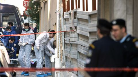 """A bomb squad team collects evidence at a construction site where a rocket was launched near the <a href=""""http://www.time.com/time/world/article/0,8599,1577262,00.html#ixzz1XpywafjU"""" target=""""_blank"""" target=""""_blank"""">U.S. Embassy in Athens, Greece,</a> on January 12, 2007. The anti-tank missile tore through the embassy, but there were no injuries."""