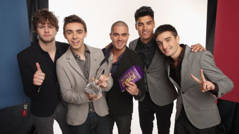"""The Wanted released their self-titled debut album in 2010, and by 2012 their song """"Glad You Came"""" was inescapable. Jay McGuiness, Nathan Sykes, Max George, Siva Kaneswaran and Tom Parker, here after receiving a 2013 People's Choice award, are repped by Justin Bieber's manager Scooter Braun, so they know a thing or two about heartthrobbing. The group has appeared on TV in the E! reality show """"The Wanted Life,"""" and their album """"Word of Mouth"""" was released in September 2013."""