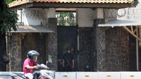 An Indonesian policeman outside the US embassy in Jakarta on August 4, 2013. Interpol issued a global security alert after jailbreaks linked to Al-Qaeda freed hundreds of militants.
