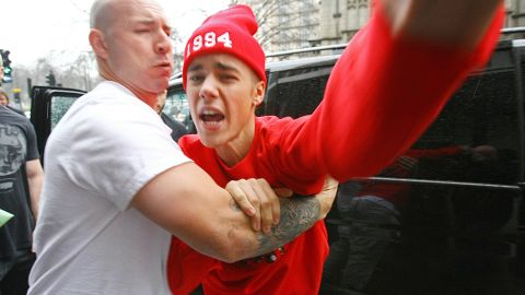 """Bieber and photographers, we've learned by now, don't mix. As he exited the hospital at the end of his turbulent week, the singer got into a shouting match with a paparazzo in London, <a href=""""http://www.cnn.com/2013/03/08/showbiz/justin-bieber-hospital/index.html"""" target=""""_blank"""">telling the photographer that he'd """"f*** him up.""""</a>"""
