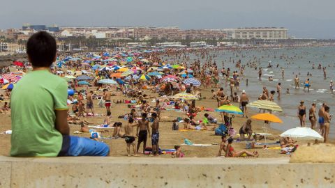 A boy takes in the scenery at Malvarrosa Beach in Valencia, Spain, on the Mediterranean on Monday, August 5.