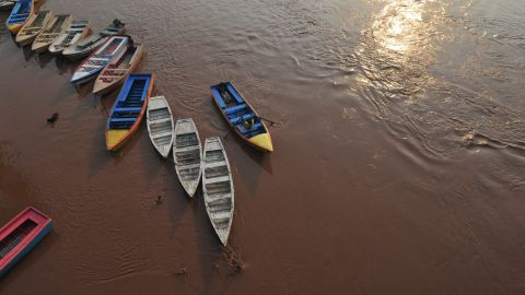 """A man prepares to secure his boat on the Ravi River in Lahore, Pakistan, on August 4.<a href=""""http://www.cnn.com/2013/08/05/world/asia/pakistan-flooding/index.html""""> More than 50 people have died</a> in flooding across Pakistan, officials say."""