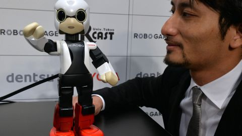 Japan's Tokyo University robot creator Tomotaka Takahashi demonstrates a humanoid robot Kirobo which reacts to Takahashi's voice and speaks with gestures in Tokyo on June 26, 2013.