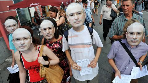 Wearing masks of Mikhail Khodorkovsky opposition activists take part in a demonstration marking the 50th birthday of the jailed Russia's former richest man in St. Petersburg on June 26, 2013.