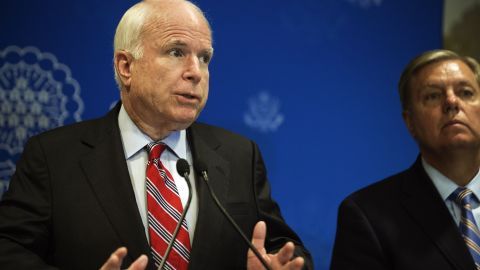 US Republican Senators John McCain (L) and Lindsey Graham (R) address a news conference on August 6, 2013 in Cairo, Egypt.