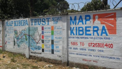 """Mobile phones are helping African citizens hold their governments to account, says Loren Treisman.<br /><br /><a href=""""http://www.mapkibera.org/"""" target=""""_blank"""" target=""""_blank"""">Map Kibera Trust</a> has used mapping information from mobiles to create a security map on two walls in Kibera, Nairobi. Wall painting helped provide security information during Kenya's general election, showing political and trouble hotspots in the area."""