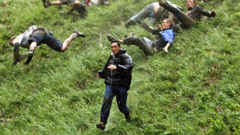 Each year, hordes of competitors join in the annual Cooper's Hill Cheese Rolling, and race an eight-pound Double Gloucester cheese down a steep hill. It is not uncommon for the day to end in an ambulance ride.