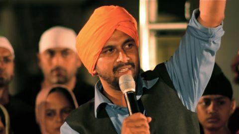 Amardeep Kaleeka, whose father was killed fighting the Sikh temple gunman, speaks at the vigil.
