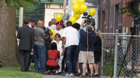 Former captive Michelle Knight, center, talks with reporters on August 7 outside convicted kidnapper Ariel Castro's house. Knight was on hand as workers began tearing down the structure.