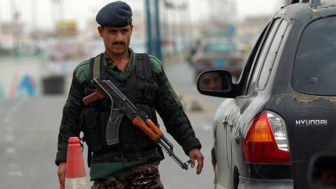 A Yemeni soldier checks vehicles near Sanaa International Airport on August 6, 2013 in Yemen.
