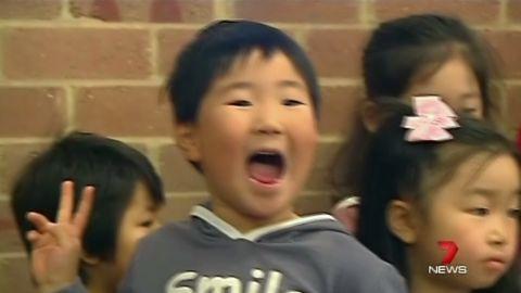 pkg kid photobombs politician australia _00000707.jpg