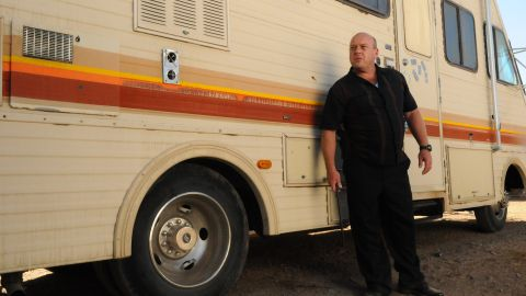 Walt's brother-in-law Hank (Dean Norris), a DEA agent, tracks down the RV that Walt and Jesse have been using as a meth lab, trapping Walt and Jesse, who are hiding inside. But Walt orchestrates a fake emergency phone call to lure Hank away and escape without being identified.