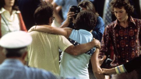 """Riggs and King embrace after the match at Houston in 1973. King said had she not won she would have """"set us back 50 years."""""""