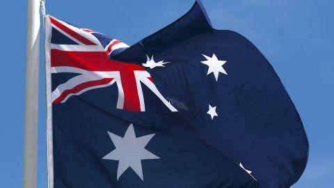 An Australian flag waves in the wind.