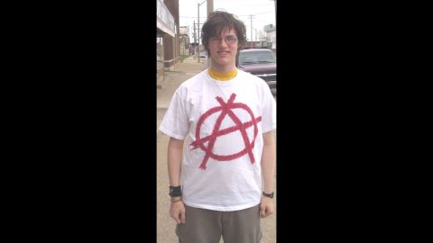 """In 2004, Timothy Gies, a senior at Bay City Central High School in Michigan, was <a href=""""http://www.cnn.com/2005/US/08/12/style.rules/"""">suspended several times</a> for wearing shirts and sweat shirts with anarchy symbols, peace signs, upside-down American flags and an anti-war quote from Albert Einstein."""