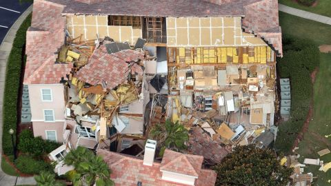 Buildings collapse into a sinkhole at the Summer Bay Resort on U.S. Highway 192 in Clermont, Florida, Monday, August 12, 2013. Guests had only 10 to 15 minutes to escape the collapsing buildings at the Summer Bay Resort on U.S. Highway 192 in the Four Corners area, located about 7 miles east of Walt Disney World resort, where a large sinkhole- about 60 feet in diameter and 15 feet deep- opened in the earth late Sunday. (Red Huber/Orlando Sentinel/MCT via Getty Images)