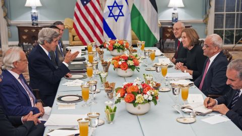 US Secretary of State John Kerry (center-L) hosts dinner for the Middle East Peace Process Talks, at the Department of State with Israeli Mr. Isaac Molho (right rear) , Israeli Justice Minister Tzipi Livni (right 2nd from end) and Palestinian chief negotiator Saeb Erekat (3rd), and Palestanian Dr. Shtayyeh (lower right corner) in the Thomas Jefferson Room of the US Department of State July 29, 2013, in Washington, DC