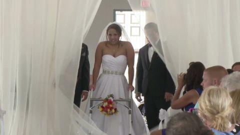 dnt paralyzed bride walks down aisle_00000327.jpg