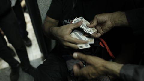 The national identity cards of protesters allegedly killed during a clear-out operation by Egyptian security forces on pro-Morsy demonstrators are exchanged at the Rabaa al-Adawiya Medical Center on August 14, 2013.