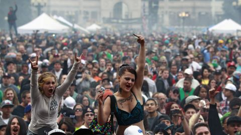 """Members of a crowd numbering tens of thousands smoke and listen to live music at the Denver 420 Rally on April 20, 2013. <a href=""""http://www.cnn.com/2013/04/20/opinion/reiman-marijuana-day/index.html"""">Annual festivals celebrating marijuana</a> are held around the world on April 20, a counterculture holiday."""