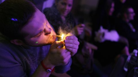 """A man smokes a joint during the official opening night of Club 64, a marijuana social club in Denver, on New Year's Eve 2012. Voters in <a href=""""http://www.cnn.com/2012/11/07/politics/marijuana-legalization/index.html"""">Colorado and Washington state</a> passed referendums to legalize recreational marijuana on November 6, 2012."""