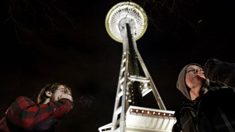 People light up near the Space Needle in Seattle after the law legalizing the recreational use of marijuana went into effect in Washington on December 6, 2012.