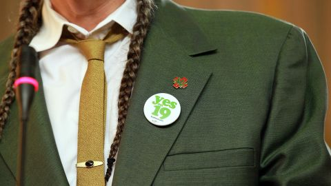 """Marijuana activist Steve DeAngelo wears a """"Yes on Prop 19"""" button as he speaks during a news conference in Oakland, California, on October 12, 2010, to bring attention to the state measure to legalize marijuana for recreational purposes in California. <a href=""""http://www.cnn.com/2010/POLITICS/11/02/ballot.initiatives/index.html"""">Voters rejected the proposal.</a>"""