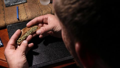 A patient prepares to smoke at home in Portland, Maine, on October 22, 2009, a decade after the state approved a medical marijuana referendum.