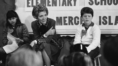 """First lady Nancy Reagan participates in a drug education class at Island Park Elementary School on Mercer Island, Washington, on February 14, 1984. She later recalled, """"A little girl raised her hand and said, 'Mrs. Reagan, what do you do if somebody offers you drugs?' And I said, 'Well, you just say no.' And there it was born."""" She became known for her involvement in the """"Just Say No"""" campaign."""